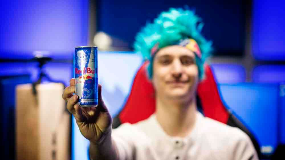 ninja holding a red bull can